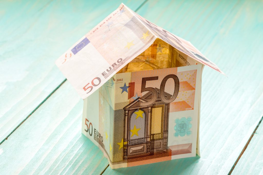 House made of Euro banknotes on a wooden background
