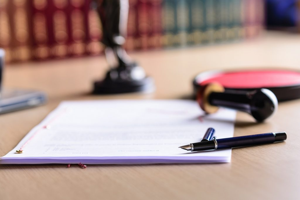 Contract waiting for a notary public sign on desk. Notary public accessories